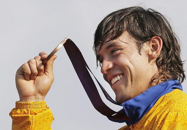 奥运图:拉脱维亚选手小轮车摘金 哥伦比亚选手