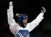 奥运图:女子67公斤以下级铜牌争夺 大吼庆祝