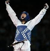 奥运图:女子67公斤以下级铜牌争夺 开心怒吼