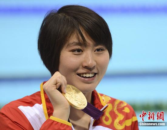 资料图:当地时间8月1日,伦敦奥运会女子200米蝶泳比赛中,中国选手焦刘洋凭借出色的发挥以2分04秒06的好成绩为中国军团夺取第17金。记者 廖攀 摄