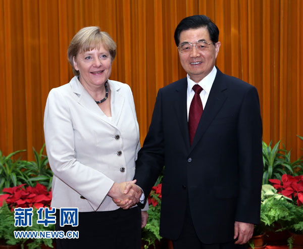 8月30日,国家主席胡锦涛在北京人民大会堂会见德国总理默克尔。新华社记者 庞兴雷 摄