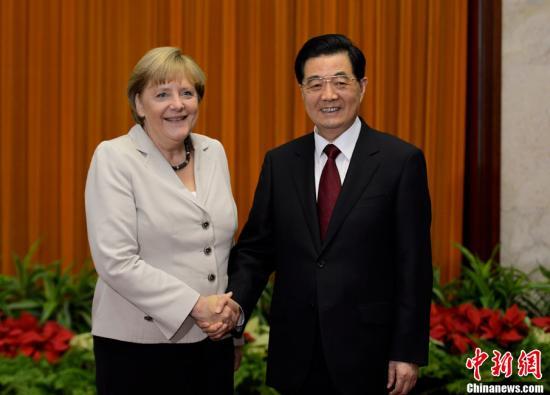 8月30日,中国国家主席胡锦涛在北京人民大会堂会见了德国总理默克尔。中新社发 廖攀 摄