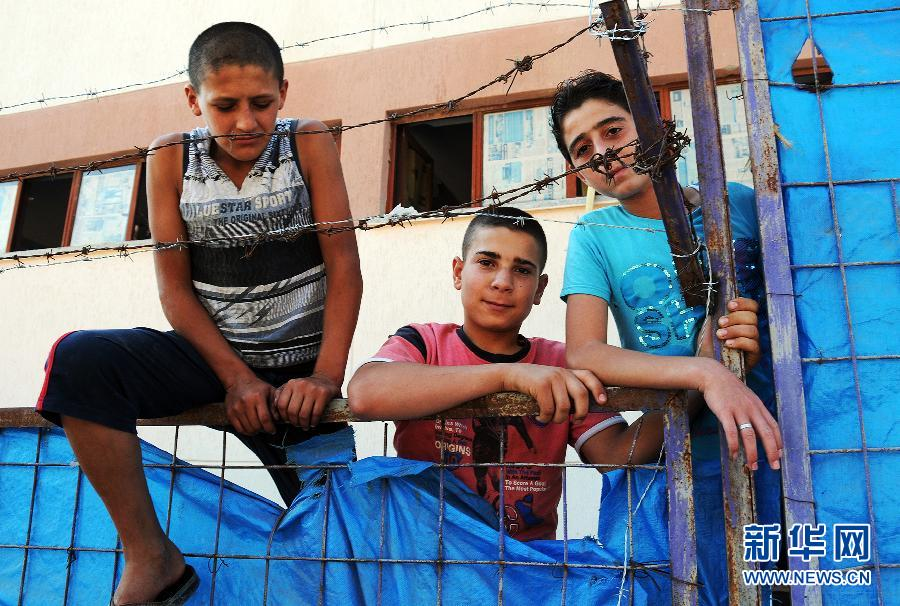 儿童 哈塔伊 叙利亚 南部/9月13日,叙利亚难民儿童在土耳其南部哈塔伊省的叙利亚难民营...
