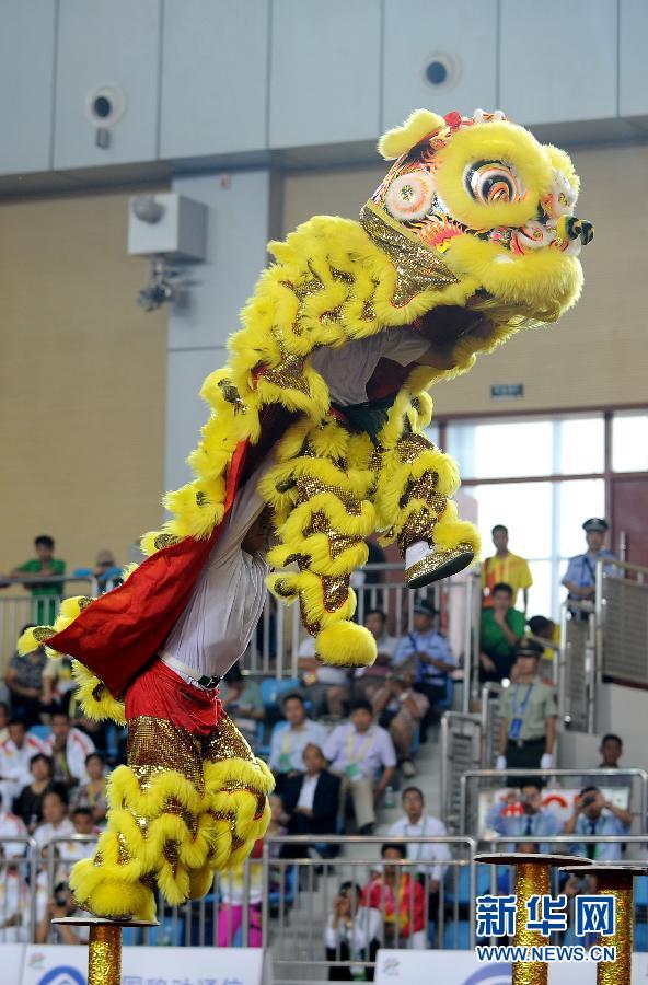 广东 苏影/9月17日,广东队在舞龙舞狮比赛南狮(规定)项目的比赛中。