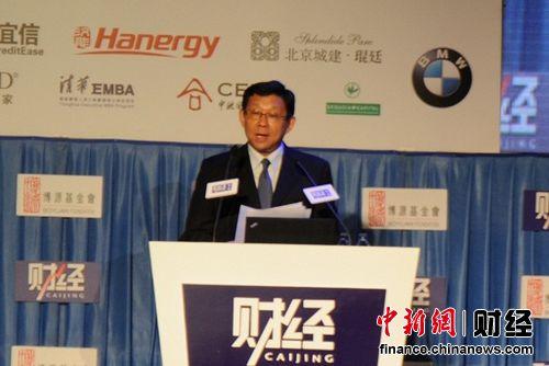 """商务部部长陈德铭在""""《财经》年会2013""""上表示,初步预测明年国际外贸形势会略好于今年,明年下半年又会略好于年初。中新网 李金磊摄"""