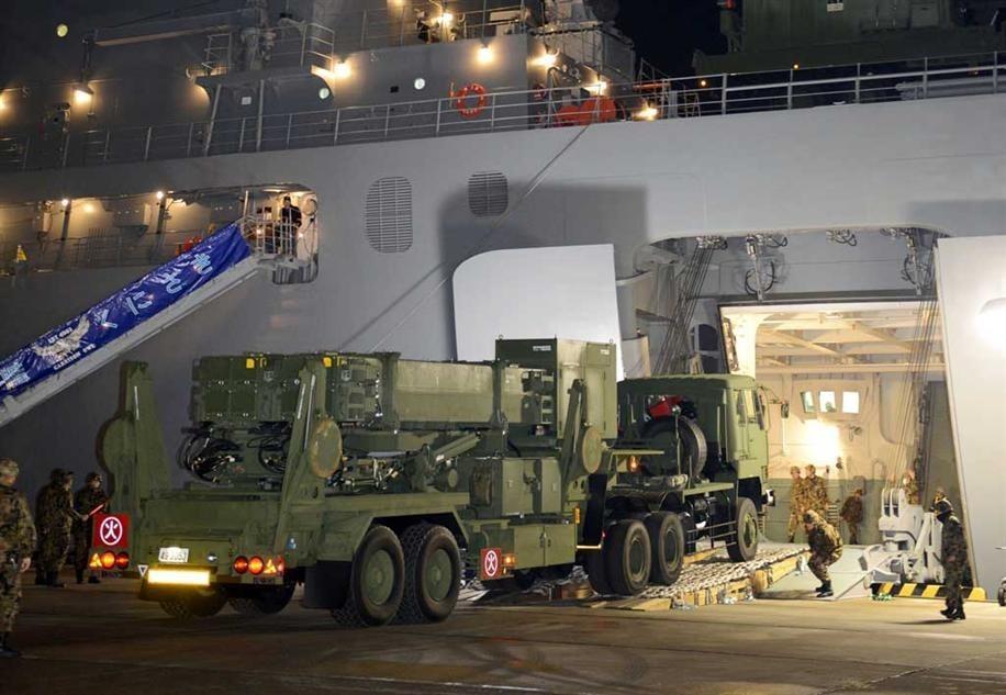 """日本""""爱国者3""""(PAC3)型导弹拦截系统即将运抵冲绳。"""