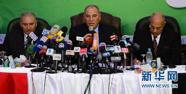 12月11日,埃及法官组织主席艾哈迈德・赞德中在记者会上讲话。新华社发