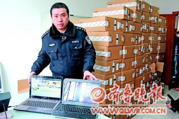 民警追回了所有的电脑。本报记者 杜洪雷 摄
