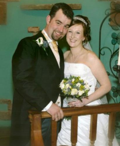 穆尔与妻子的合影。