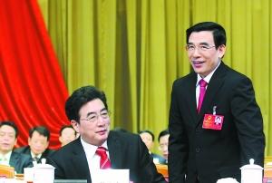 昨天,市委书记郭金龙和代市长王安顺出席市十四届人大一次会议。 本报记者 戴冰摄