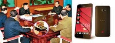 韩国《中央日报》4日报道,金正恩近日主持会议的照片显示(上图),他所使用的手机是台湾品牌宏达电(HTC)蝴蝶机(左图)。(法新社资料照片)台湾《中国时报》