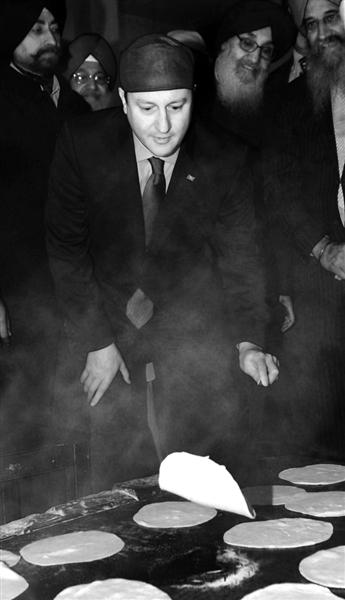 英首相访印 学翻烙饼