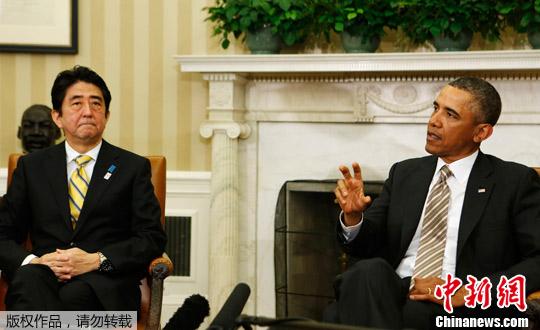 正在美国访问的日本首相安倍晋三22日在白宫与奥巴马进行首次会晤。