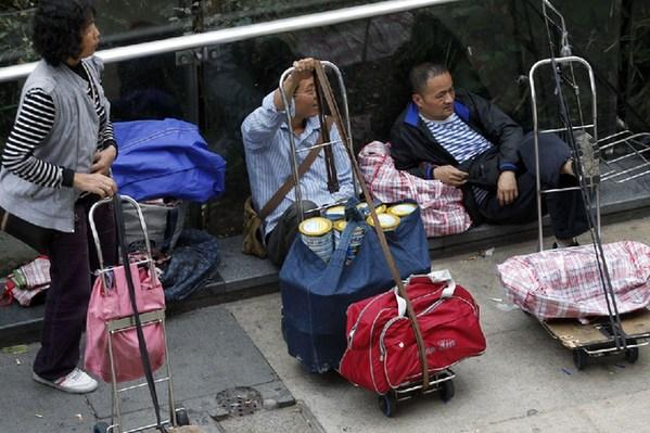 如何让百姓对内地奶粉重拾信任?――香港限粉令引热议