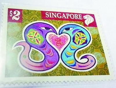 厦门八旬邮票迷晒宝贝 全球首张蛇邮票都有 图图片