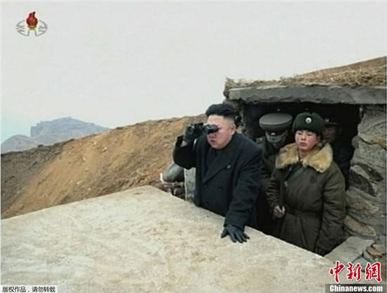 资料图:金正恩下令备战并视察前线。