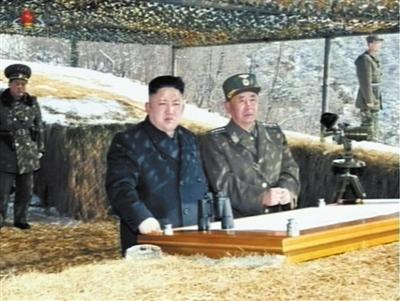20日,朝鲜电视台画面显示,金正恩指导朝军高射火箭训练。