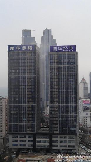 国华大厦高层失火 世界级登高平台消防车亮相(图)