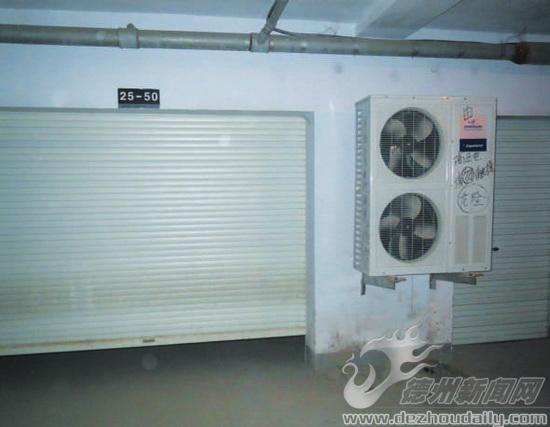 被改装成冷藏间的车库以及空调制冷外机.