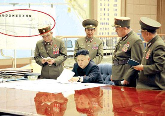 资料图:朝鲜官方媒体图片中的红圈部分显示的对美作战计划。