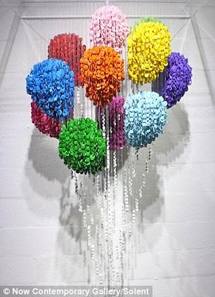 美国艺术家用纽扣打造名画《蒙娜丽莎》(组图)图片