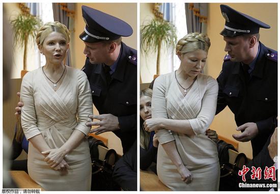 10月11日,乌克兰前总理季莫申科在听取法庭判决时讲话,一名法警要求她保持安静。乌克兰一家法院当地时间11日宣布,前总理季莫申科因在乌俄两国天然气供应协议中滥用职权被判处7年监禁。