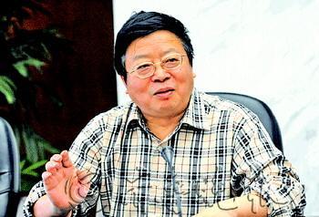 重庆市地产集团原董事长周天云。 (资料片)