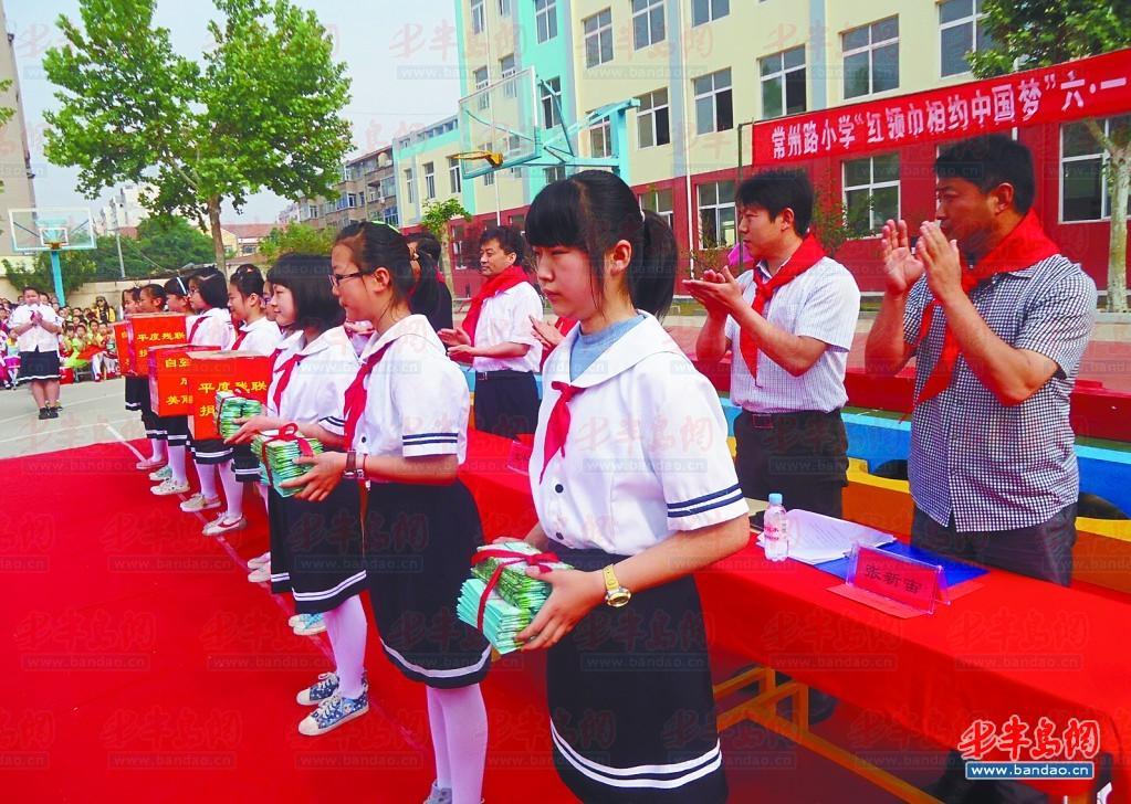 书签 平度市/为了迎接六一儿童节的到来,5月31日上午,平度市残联为常州路...