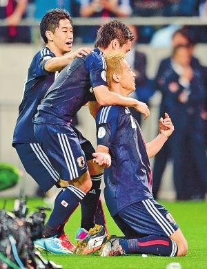 日本队晋级2014年巴西世界杯 新华社供图