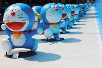 上海 仁川/一个憨态可掬的蓝胖子,一只可爱的橡皮大黄鸭,最近因为它们的...