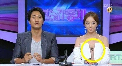 韩国女主播着开胸装主持 男搭档 天太热吗 图