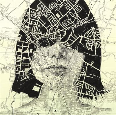 地图 剑桥/画在英国剑桥街道地图上的人像。