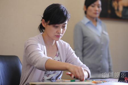 王明君(梅婷饰)在儿童之家接受测试