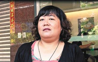 死亡渔民洪石成的女儿洪慈�P。联合报图