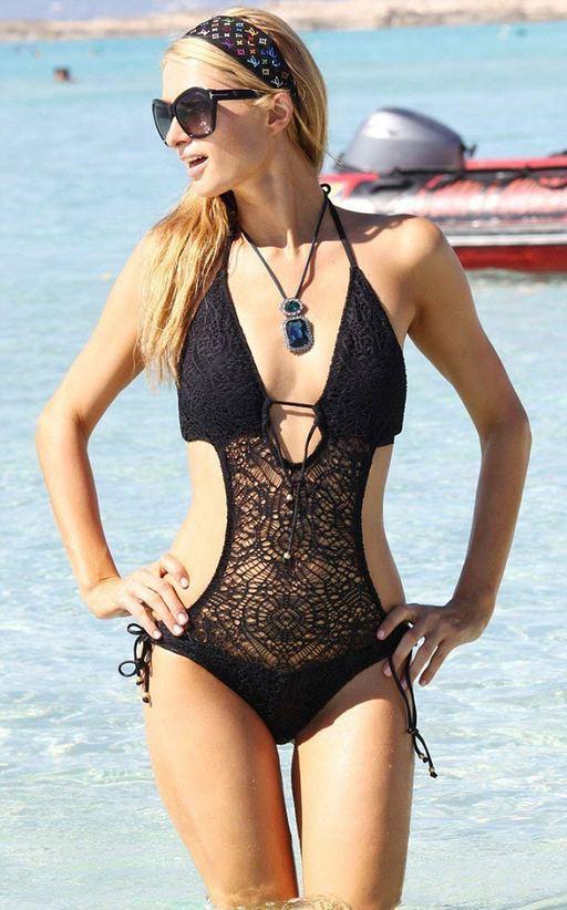 当地时间8月12日,帕丽斯·希尔顿现身西班牙Formentera岛度假,希尔顿黑色渔网比基尼美胸抢镜,海滩风骚秀蛮腰。