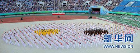 8月31日,第十二届全国运动会在辽宁省沈阳市奥体中心体育场开幕。 这是开幕式上的太极武术展示。 新华社记者王松摄