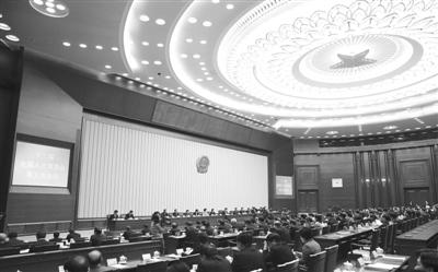 昨日,十二届全国人大常委会第五次会议在北京人民大会堂闭幕。 新华社记者 丁林 摄