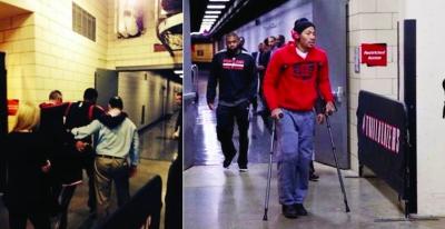 罗斯拄着拐杖离开球场。