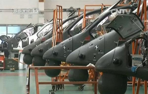 原文配图:央视新闻节目中曝光了哈飞直升机厂的直-19武装直升机的生产车间。
