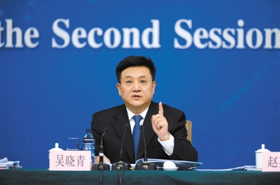 昨日,十二届全国人大二次会议新闻中心举行记者会,吴晓青回答提问。 新华社记者 王鹏 摄