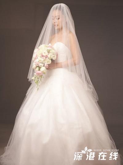 容祖儿披婚纱拍广告