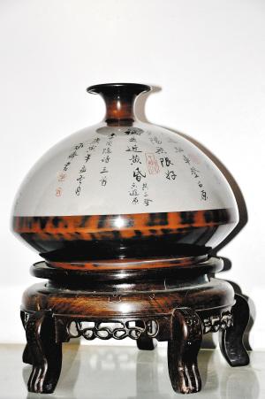 潘朝凯:融新奇古美于建水陶