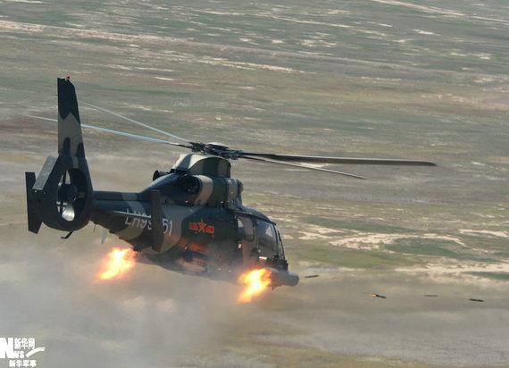 武直9是一种昼夜使用的多用途攻击直升机,主要用于执行反坦克、反装甲、压制地面火力和攻击地面零星目标的任务,也可用于突击运输、通信联络和战场救护等任务。资料图:武直9发射火箭弹瞬间。