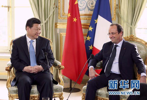 2014年3月26日,國家主席習近平在巴黎同法國總統奧朗德舉行會談(資料圖)