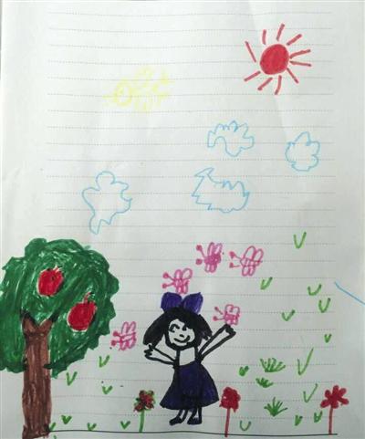 """还夸奖她手中的彩笔画""""画得不错"""".    摄 -李克强看望残疾孤儿 9岁"""