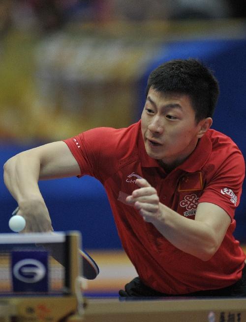 高程:2014中国乒乓球公开赛马龙图文拧反手法视距放样图片