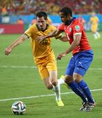 文:B组赛智利迎战澳大利亚 一对一拼抢