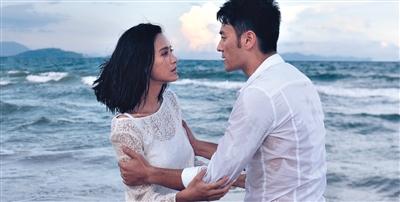 李光洁、张歆艺主演的电视剧《绝爱》海报。