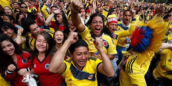 哥伦比亚球迷上街庆祝哥伦比亚队在世界杯比赛中取得胜利网页截图