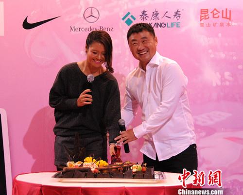 资料图:李娜与姜山。 中新网 王牧青 摄